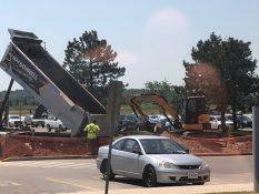 photo of truck dumping new soil