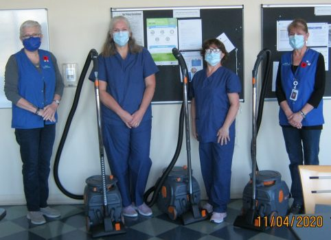 Photo of GBHS staff and new vacuums